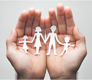 a pair of hands holding a paper cutout of a family.