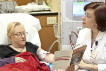 dialysis nurse and patient talking